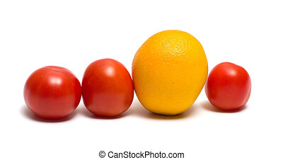 Individual. - Three red tomatoes and yellow orange on a...