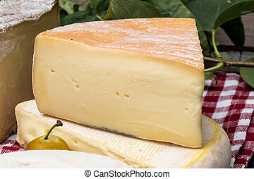 piece of cheese french of mountains and Reblochon