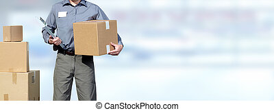 Delivery man with a parcel. - Hands of professional postman...