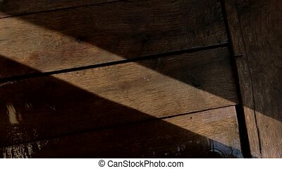 Wet wooden planks. Falling drops of water. Be careful not to...