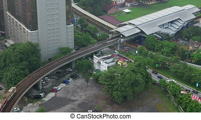 Bird eye view of railways across road against city landscape. Kuala Lumpur, Malaysia