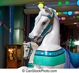 Carousel Horses at an Arcade - Horses from a carousel at an...