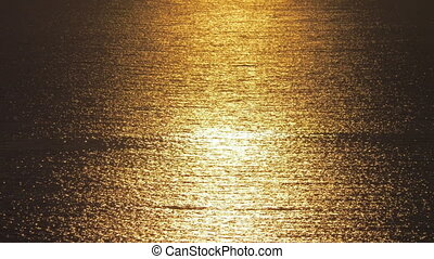 Beautiful golden sunset on sea with waves