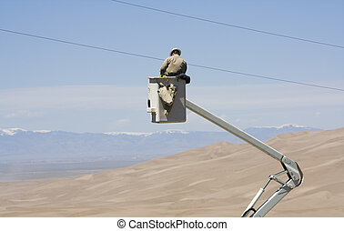 Electrician fixing power line