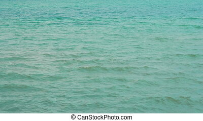 Beautiful view of the sea with small, gentle waves. Summer...