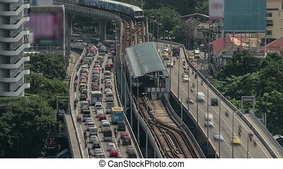 Time lapse shot of multi-level traffic road, railway and...