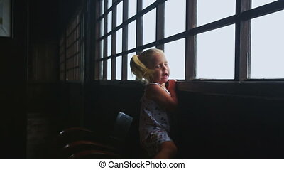 Little Blond Girl Mother Look out of Window at Foggy Landscape