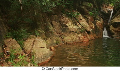 Small Waterfall in Mountain River Rocky Woody Banks -...