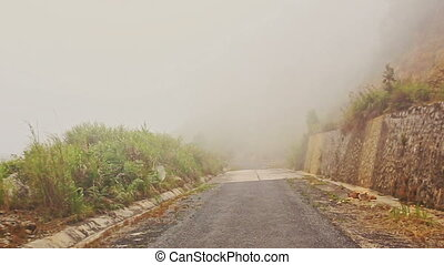 Camera Moves along Misty Mountain Asphalt Road - camera...