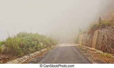 Camera Moves along Misty Mountain Asphalt Road - camera...