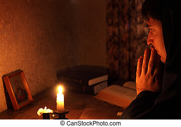 Man sitting by candlelight