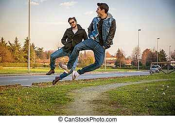 Two Men Leaping in Unison with Hands in Pockets - Pair of...