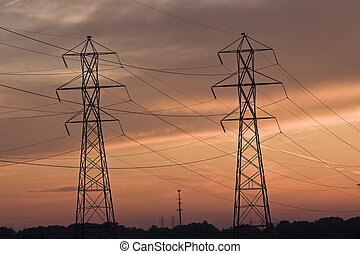 Power lines and Cell Tower at sunset