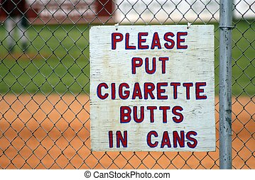 Cigarette Butts in can - sign hanging by a childrens...