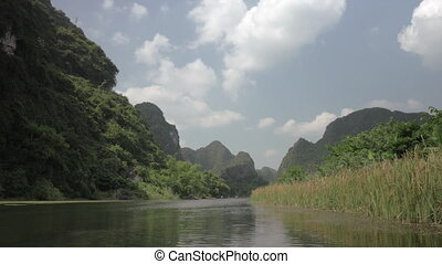 Wild nature of Trang An in Vietnam - Tour along the river in...