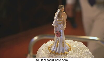 The decoration of the wedding cake. Figurine of bride and...