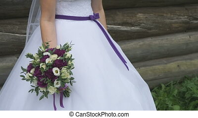 Beautiful bride holding a wedding bouquet