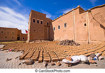 Kasbah and bricks dried on the sun, Morocco - Kasbah and...