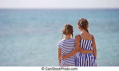 Adorable little girls together during beach vacation -...