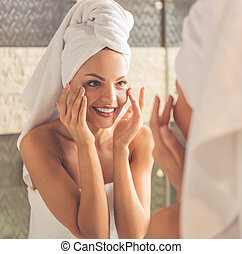 Beautiful woman in bathroom - Beautiful young woman in bath...