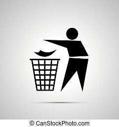 Man throwing garbage in the trash can, simple black icon