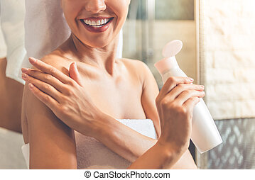 Beautiful woman in bathroom - Cropped image of beautiful...
