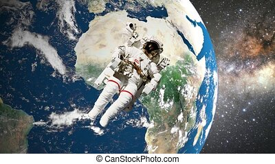 astronaut in open space in front of earth. Elements of this...