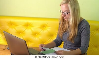 woman working with laptop - woman workig with laptop at home