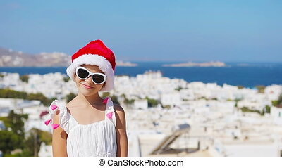 Charming girl in white dress and red hat outdoors background...