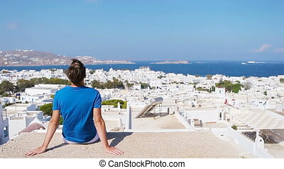 Young boy on street with amazing view on Mykonos, Greece....
