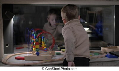 Child playing with toys at home