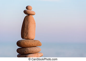 Pyramidal heap of pebbles - Balancing some of stones on the...