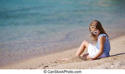 Adorable little girl at tropical beach during vacation -...