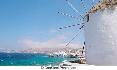 Famous view of traditional greek windmills on Mykonos island...