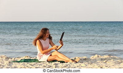beautiful girl with a tablet computer