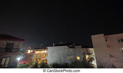 Timelapse of sky with stars over the small town - Timelapse...