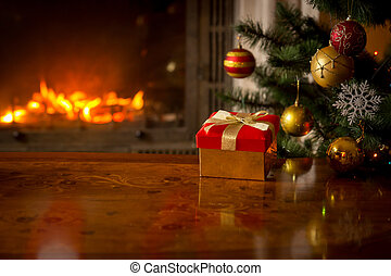 Closeup image of gift box on wooden table in front of...