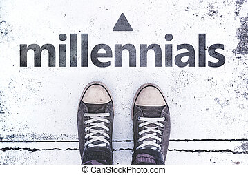 Millennials concept with pair of sneakers on the pavement,...