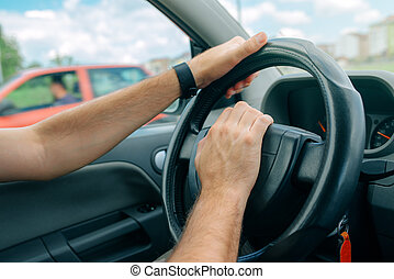 Nervous male driver pushing car horn in traffic rush hour,...