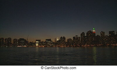 skyline by night pan shot - pan shot skyline manhattan by...