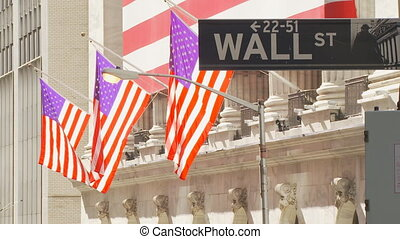 road sign on wall street - wall street road sign with flags