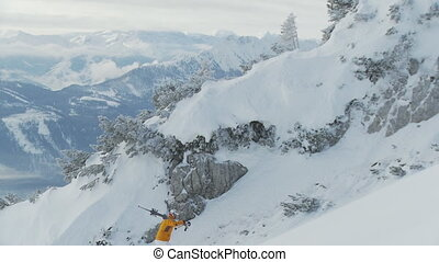 skier climbing up mountain in the morning