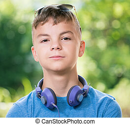 Teen boy with headphones - Portrait of a teen boy 12-14 year...