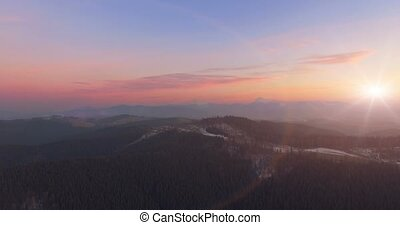 Mountain landscape at sunset. 4k 30fps - 4K Aerial Top View...