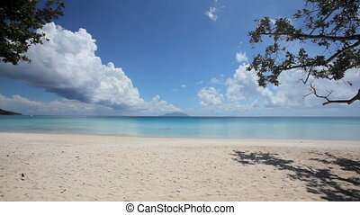 tropical beach with beautiful clouds - broad sandy beach at...