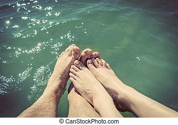 A couple in love wetting their feet in the sea. Summer...