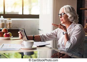 Granny communicating with her family via skype - Sending...