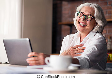 Caucasian woman being happy using computer for family...