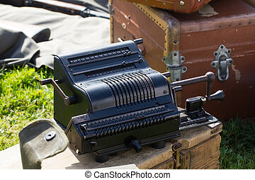 Old calculating machine - Old black mechanical calculator...