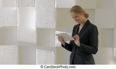 Businesswoman with tablet computer indoor - Young...
